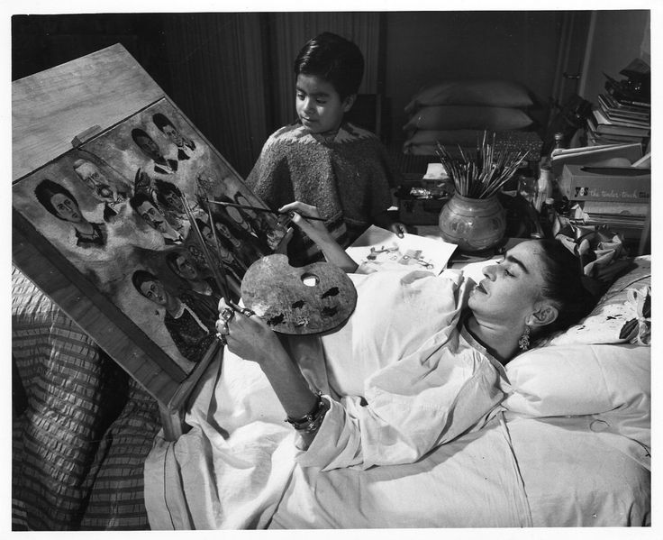 Frida Kahlo, painting in bed
