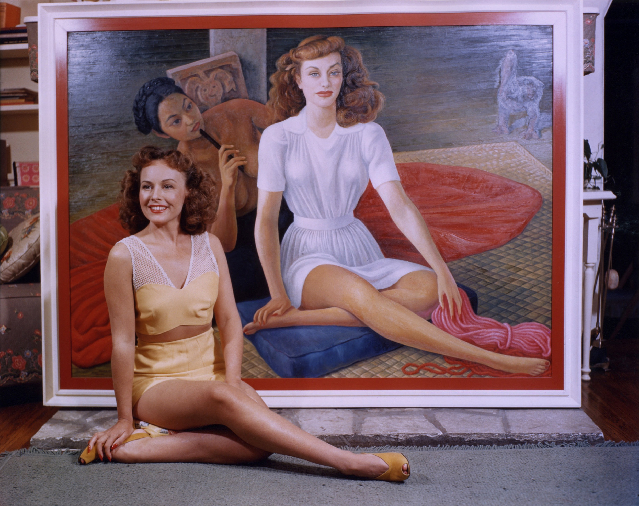Paulette Goddard with Diego Rivera's portrait of her, executed 1940-41