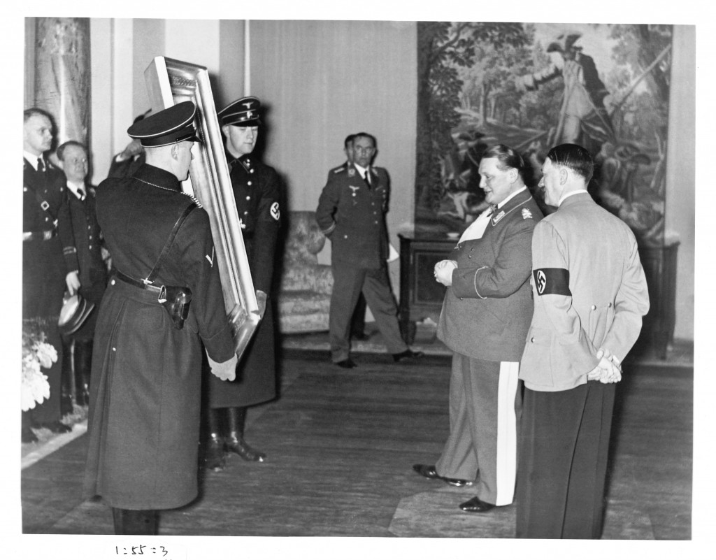 Hitler is presented with a confiscated painting