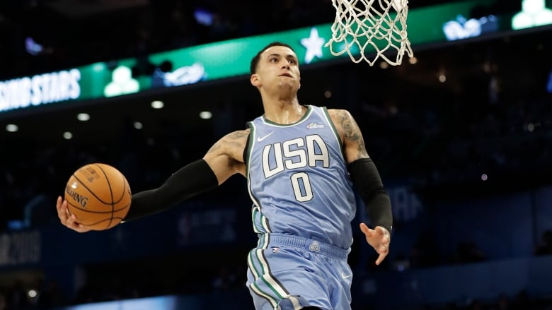 Lakers Forward Kyle Kuzma performs a ferocious slam dunk in the first half. (AP Photo/ CBC SPORTS)