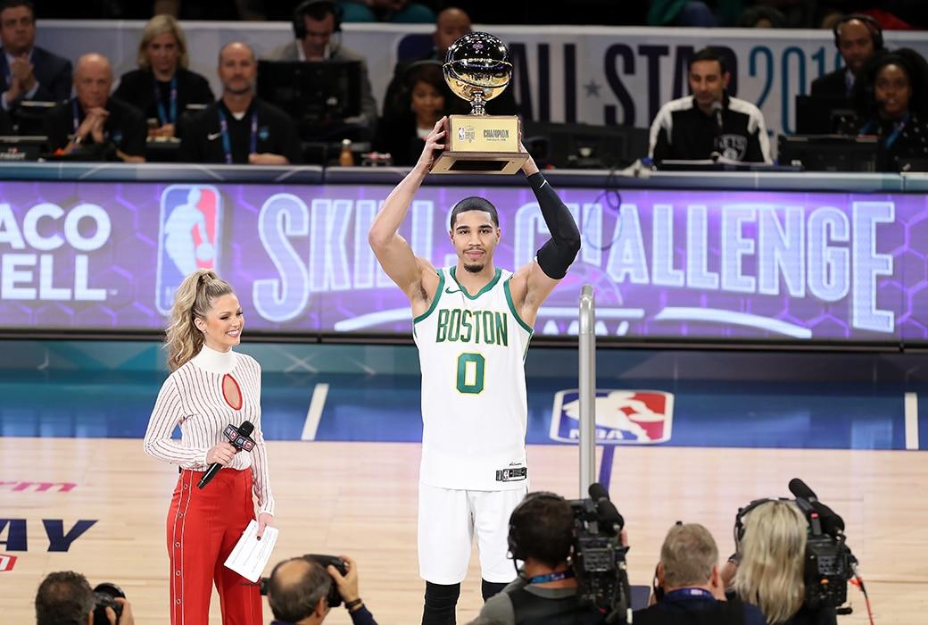 Celtics Forward Jayson Tatum hold the Skills Challenge Trophy in Charlotte,NC ( AP Photo/ SLAM MAG)