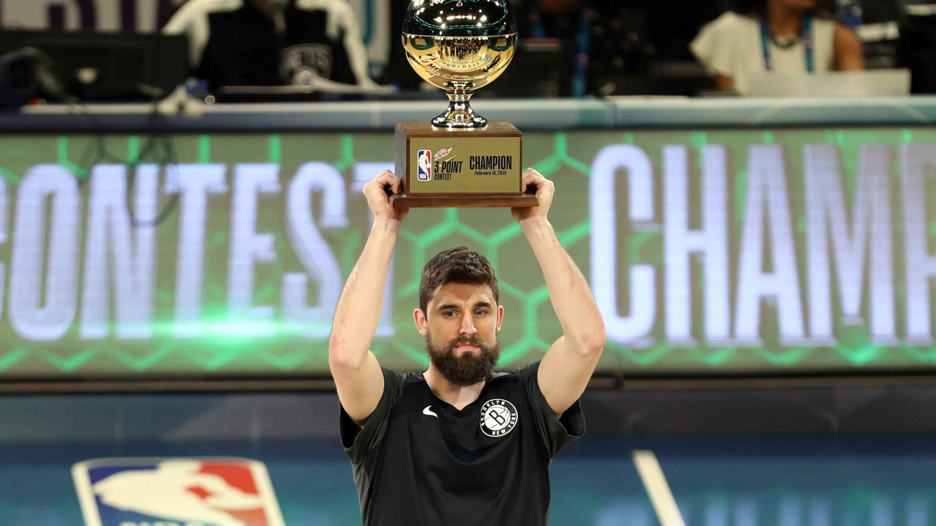 Brooklyn Nets Joe Harris received the 3-point championship trophy after defeated Stephen Curry in the finals. (AP Photo/ NBA.com)