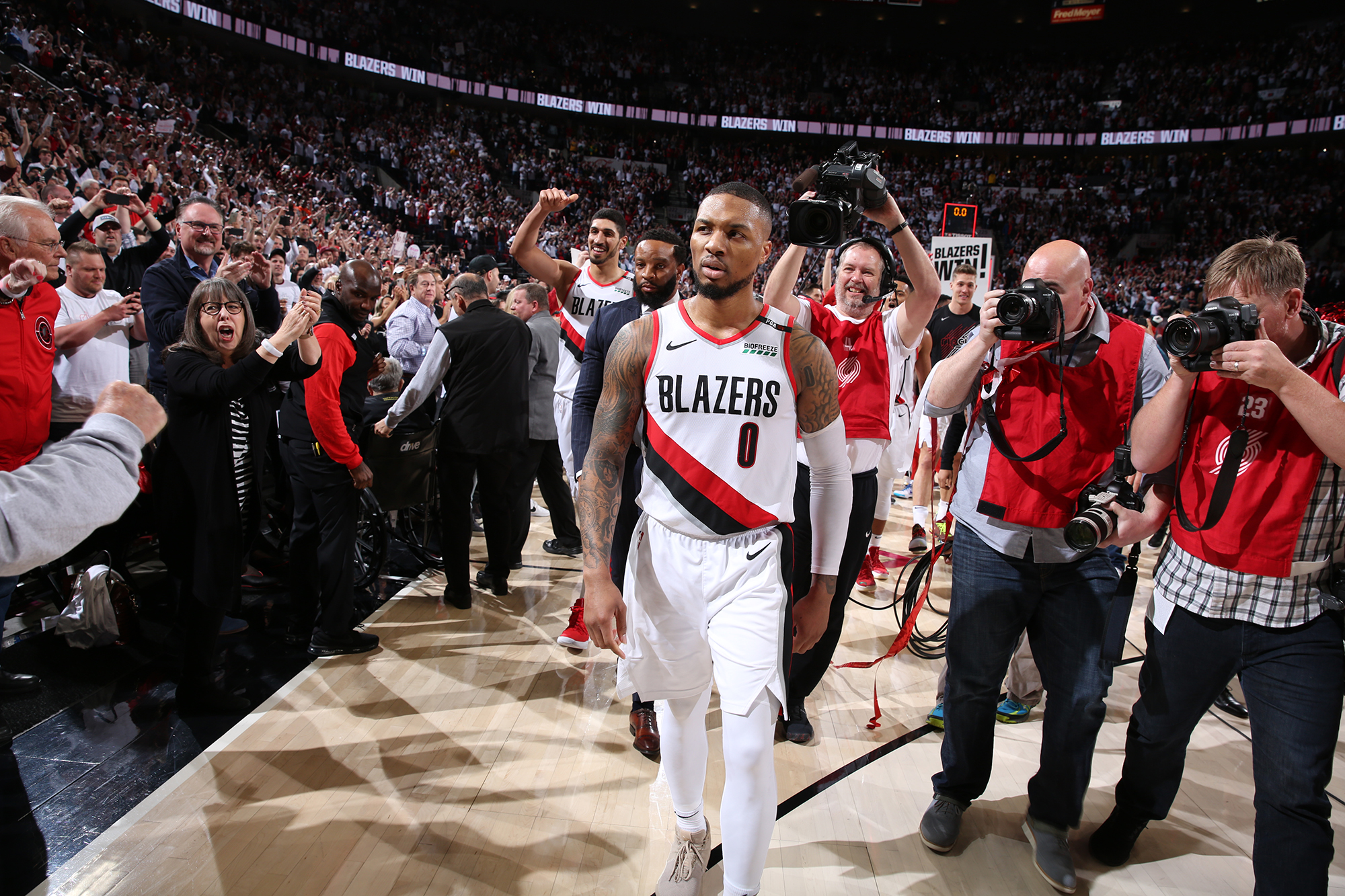 Damian Lillard walks off after post-game celebration in the first round of the NBA Playoffs (Photo by: Washington Post).