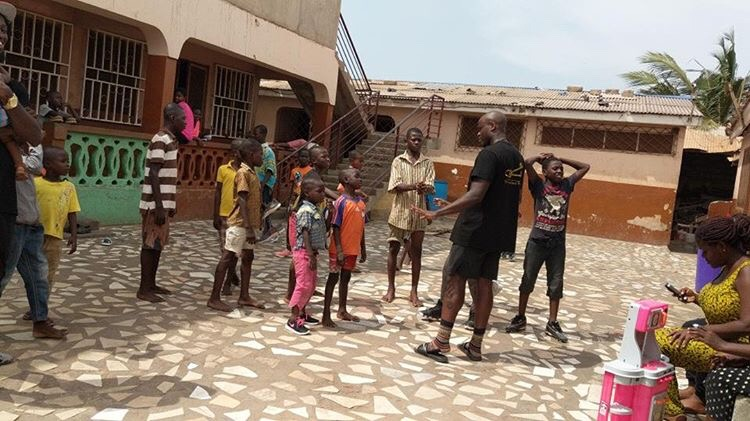 CEO Randy Osei imparting his knowledge back to the residents in Ghana. (Photo by: RozaayMGMT)