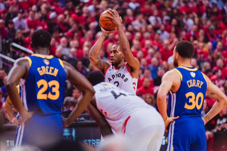 Kahwi Leonard led the way for the Raptors in their game 1 victory. (Photo by: NBA)