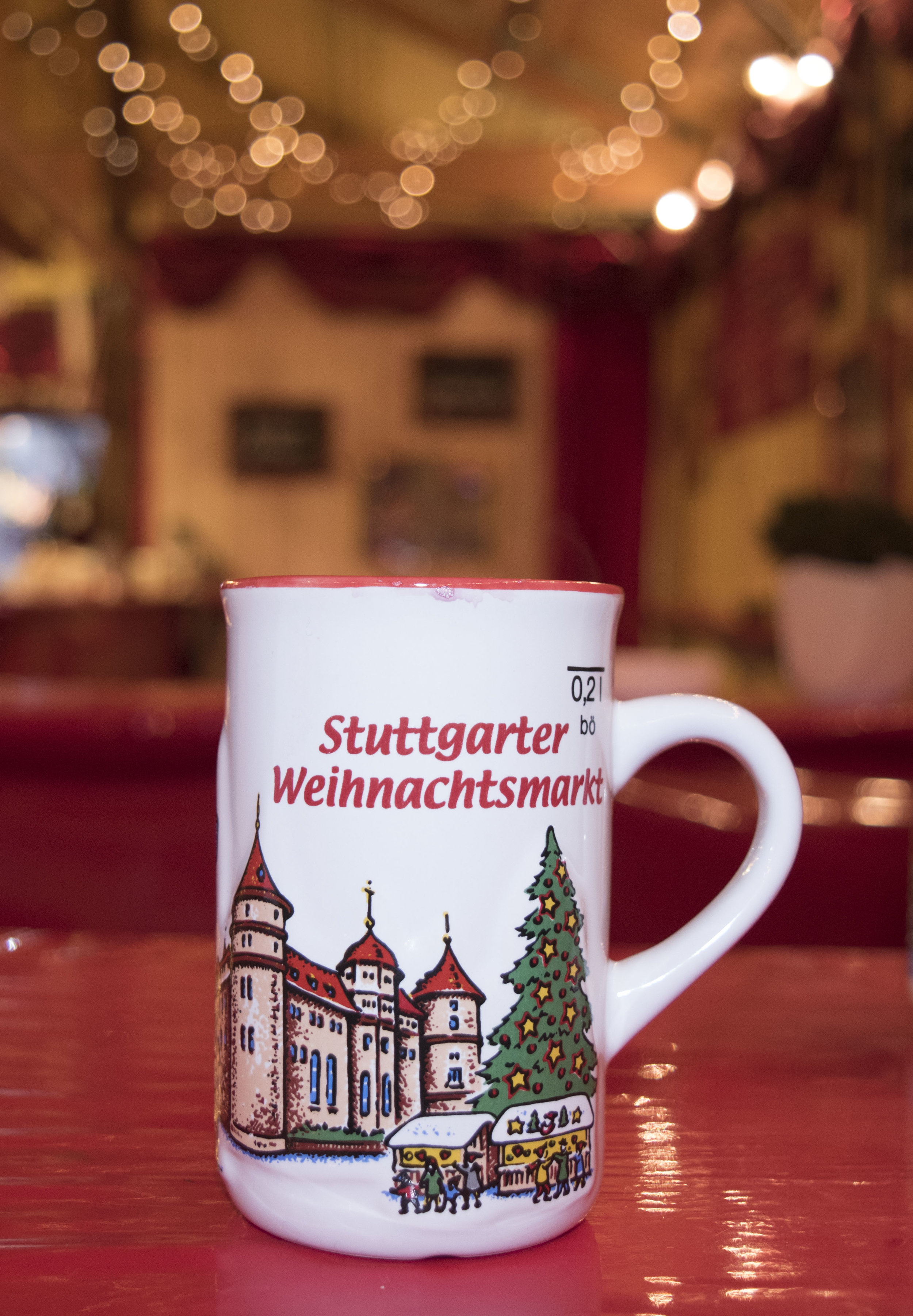 Attendees are often found drinking glühwein (mulled wine) at the Christmas Market in Stuttgart, Germany. Return the mug to the vendor if you wish to receive your deposit back, or keep it as a souvenir.