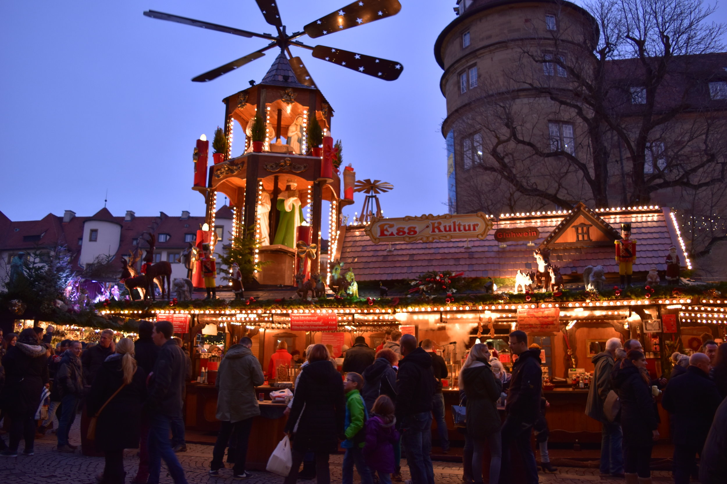 Christmas-themed booths light up the plaza at the Christmas Market in Stuttgart, Germany.