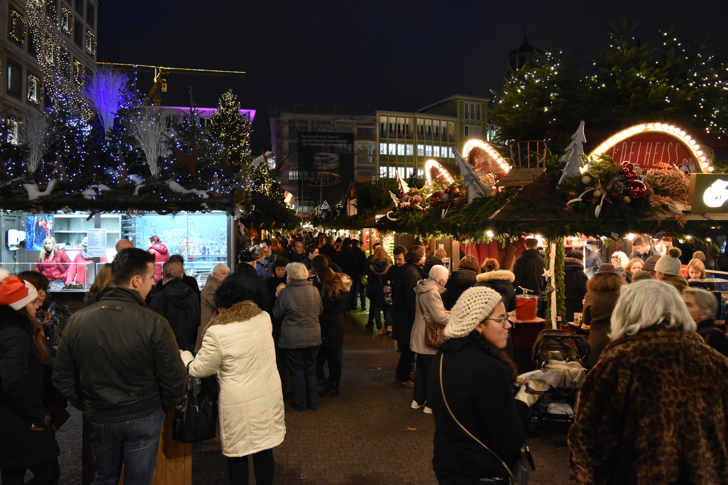 Attendees visit the row of decorative booths at the Christmas Market in Stuttgart, Germany.