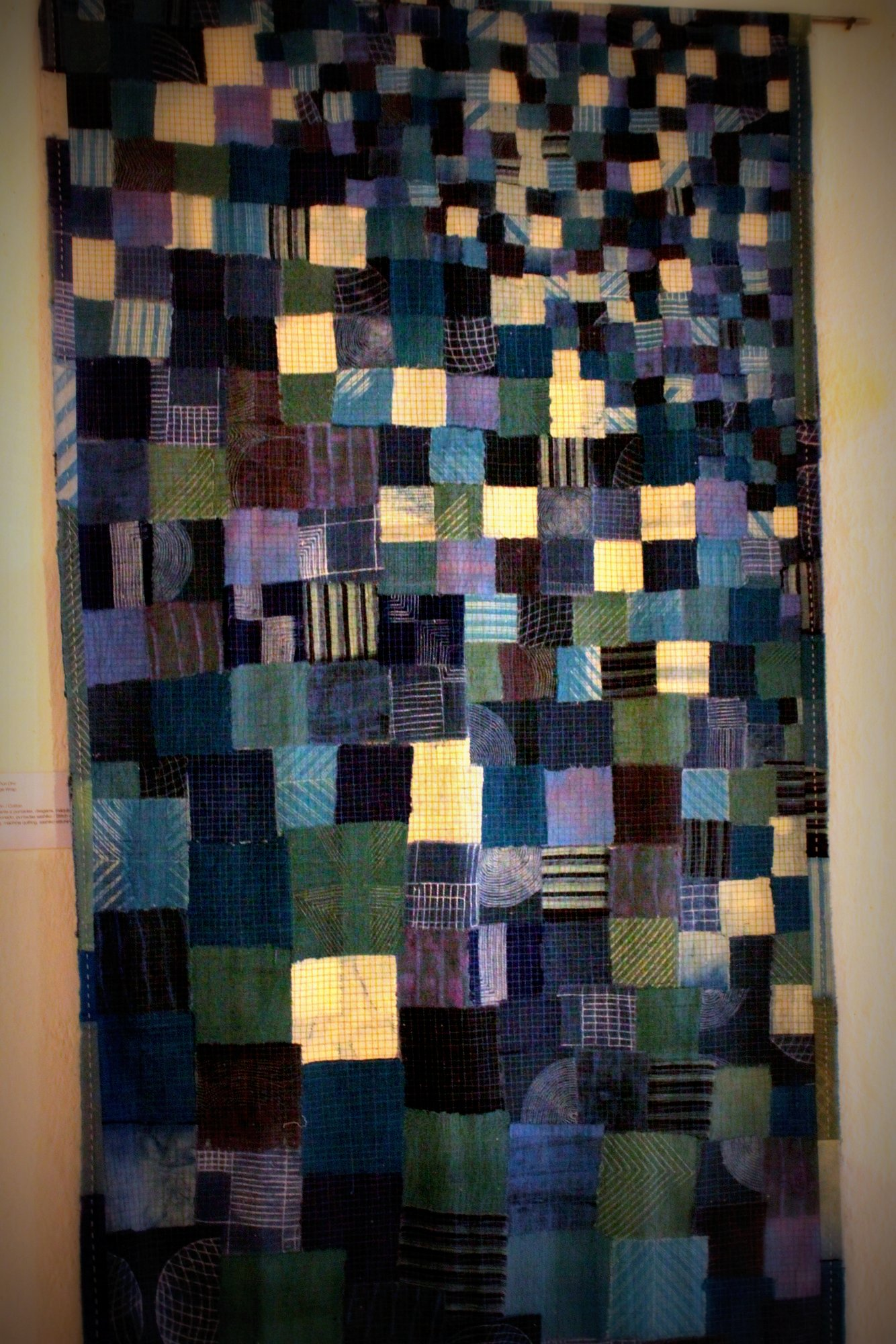 Neha Puri Dhir of India created this piece, Melange Wrap. It's also reminiscent of boro cloth, with machine quilting and sashiko stitching.