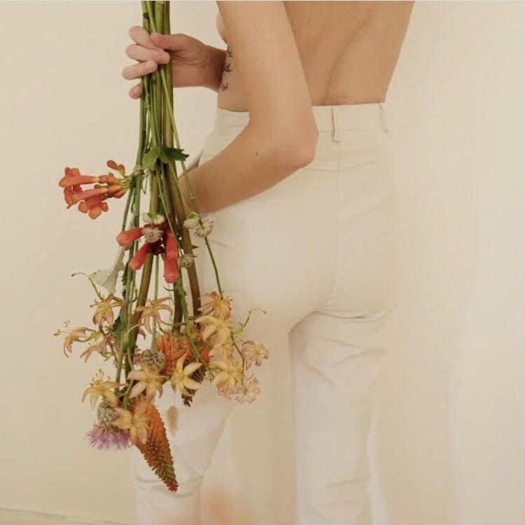 Woman Holding Flowers Upside Down