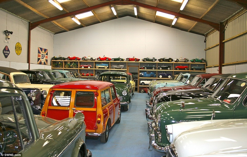 As well as full-size motors, the collection includes more than 300 miniature pedal cars, pictured at the back, as well as a Sinclair C5 from the 1980s
