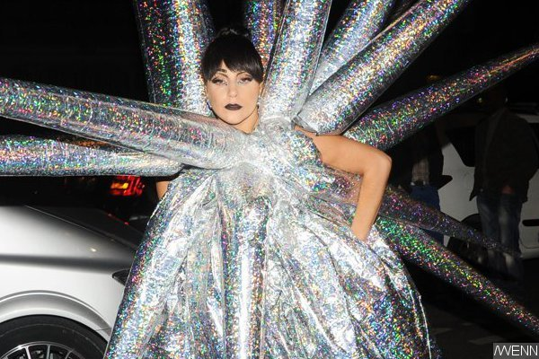 lady-gaga-turns-into-a-star-in-spiky-inflatable-outfit-in-paris.jpg