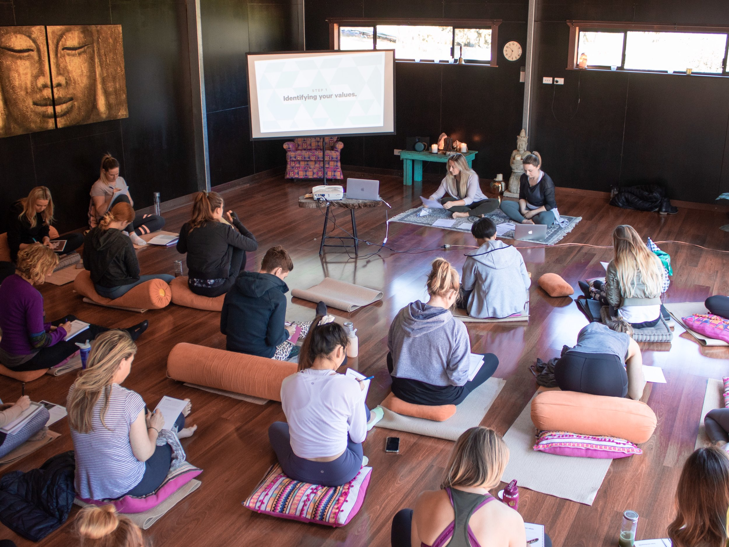 Retreat attendees take notes in a positive mindset workshop