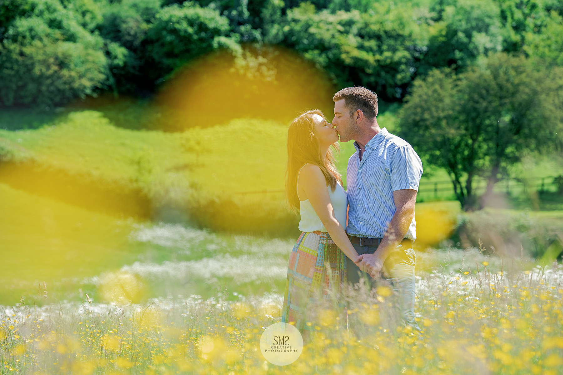 Happy couple in a wonderful private meadow in June 2018.