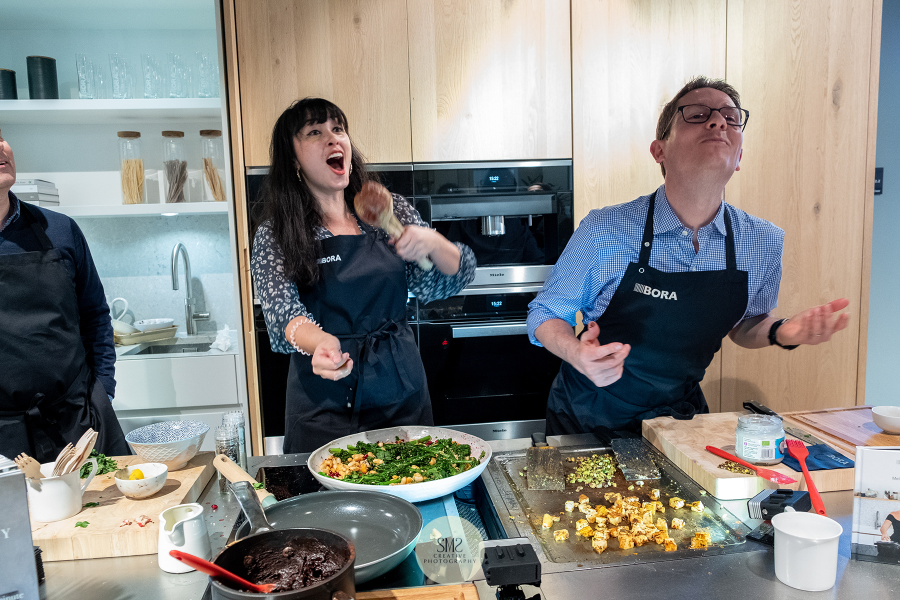 'Espresso Design' Melissa Hemsley demonstating Bora kitchen appliances and how to throw a cube of hallumi and for your co-host to  catch it in his mouth