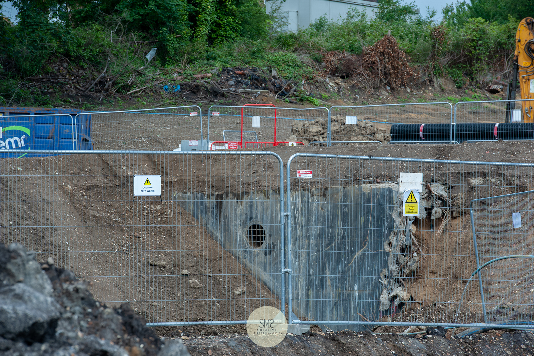 The remaining base of the gas holder is over one metre thick  and deep, is gradually broken down in preparation for the sheet piling.