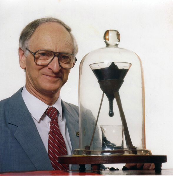 Professor Andrew White with the Pitch Drop Experiment