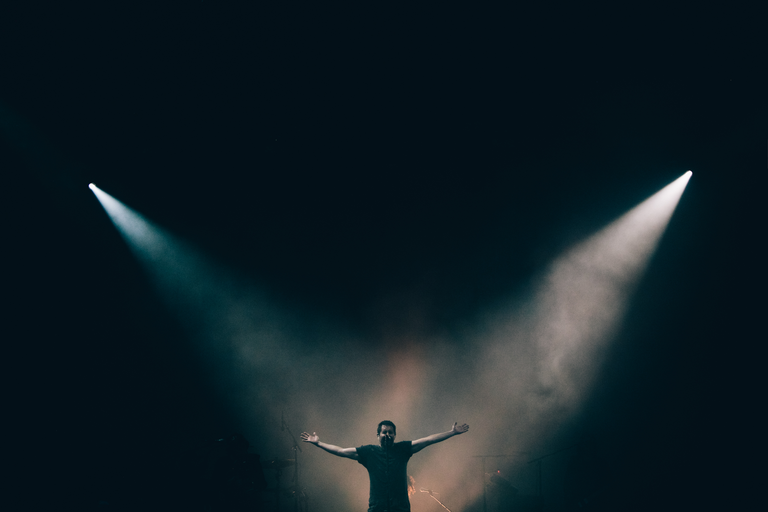Trent Reznor basks in the limelight during Nine Inch Nails' performance on Thursday 12 July. Credit: Arlindo Camacho