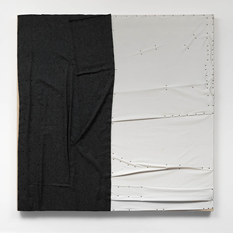 "As águas de Março,  2019 (the body in bed)  cobertor, tecido ""blackout"" e pinos de aço sobre madeira |  plywood, wall blanket, blackout material, steel pushpins   183 x 183 x 8 cm |  72 x 72 x 3 in"