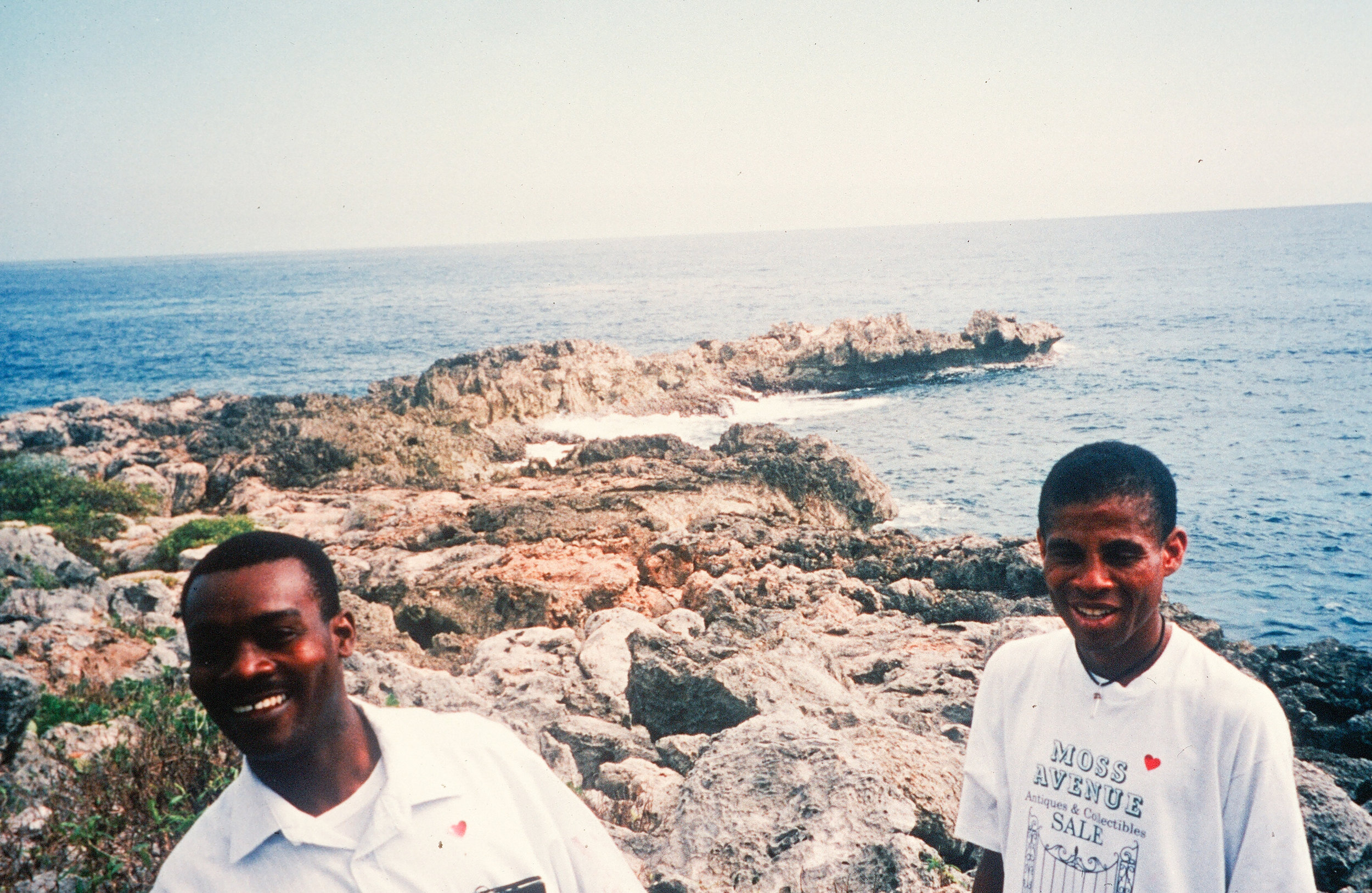 Jean Michel and Belony on the rocks behind the FOTCOH clinic.
