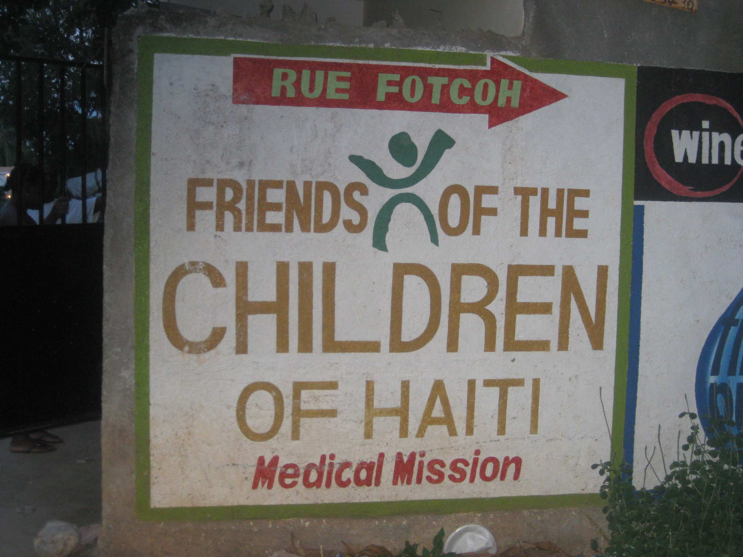 The FOTCOH sign, painted on the side of Son Son's depot.