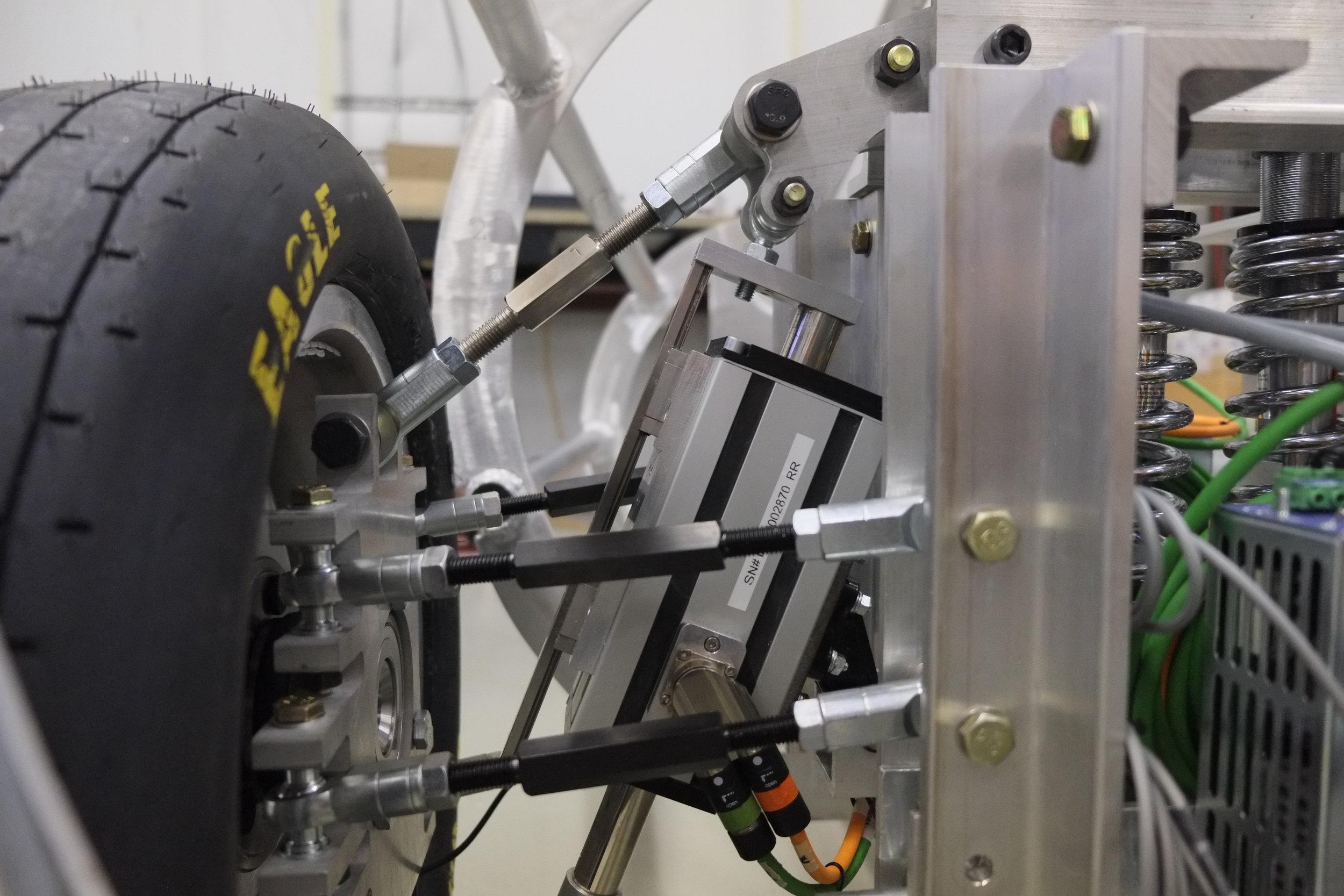 A detail of ales tech's suspension on uf Gatorloop's pod