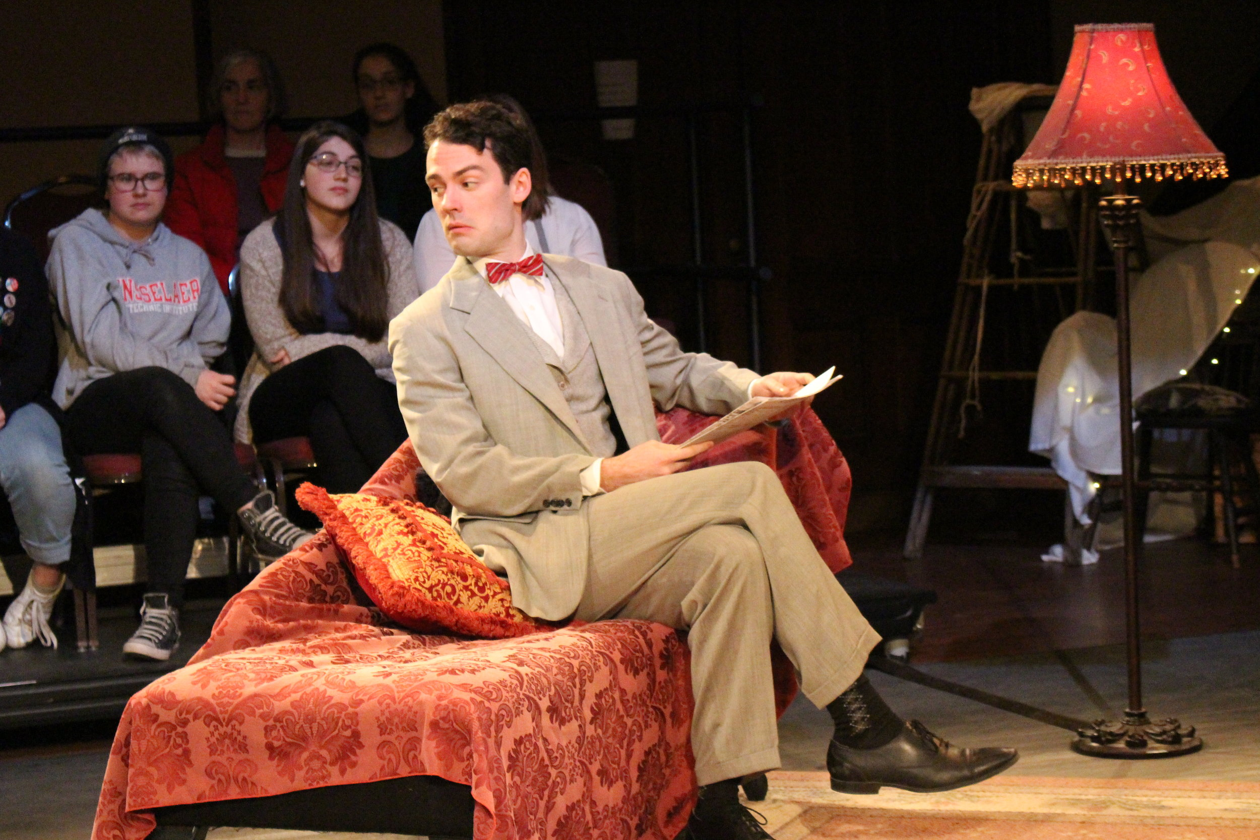 Woodrow leans over his shoulder as Jim, the gentleman caller, in Hubbard Hall's 2017 production of The Glass Menagerie director by Roger Danforth.