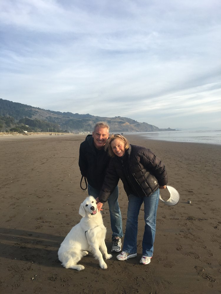 Marcia with her husband, Greg, and 7 month old dog, Ellie Mae, at Stinson Beach.