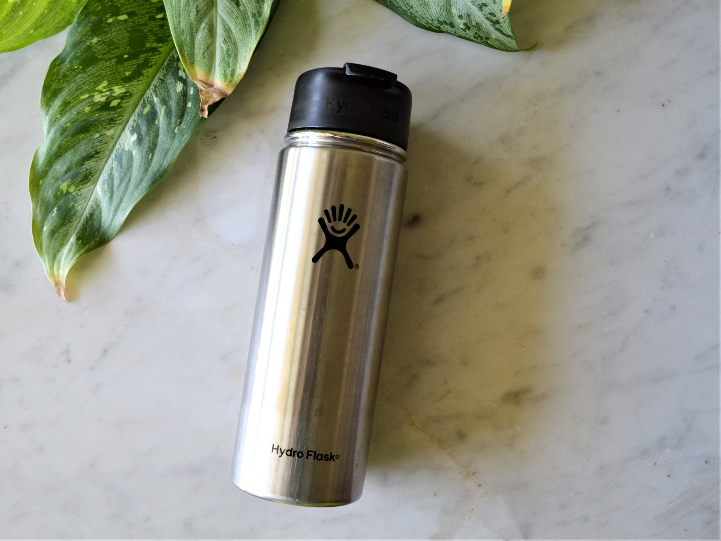Hydro Flask Thermos - Along with our diets our intake of water can be drastically thrown off course when traveling, leading to dehydration and less energy. Make sure to bring along some type of re-usable water bottle or thermos to re-fill along the way. I love using my Hydro Flask thermos because of it's air-tight lid (a.k.a no spills!) and ability to use it for hot or cold beverages.