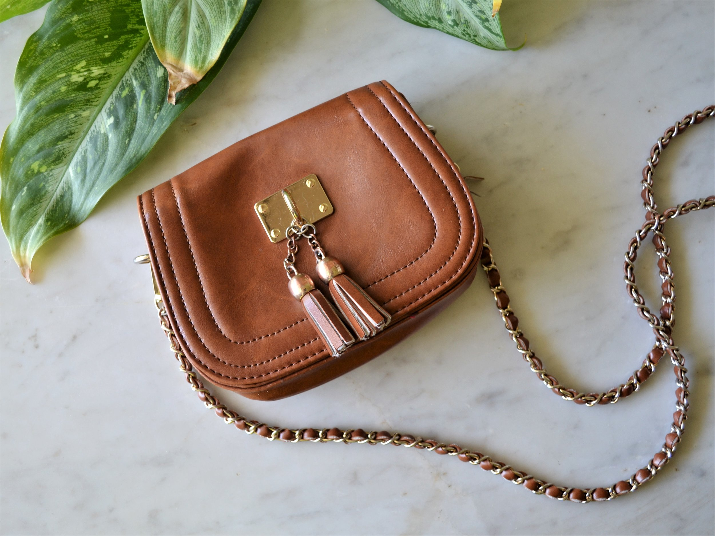 Small Purse - Having a small purse or tote is key when traveling light. It allows you to move freely throughout your day and (literally) not be weighed down. All you often need is: cash, credit card, drivers license, lipstick, phone, and a pen; and your good to go!