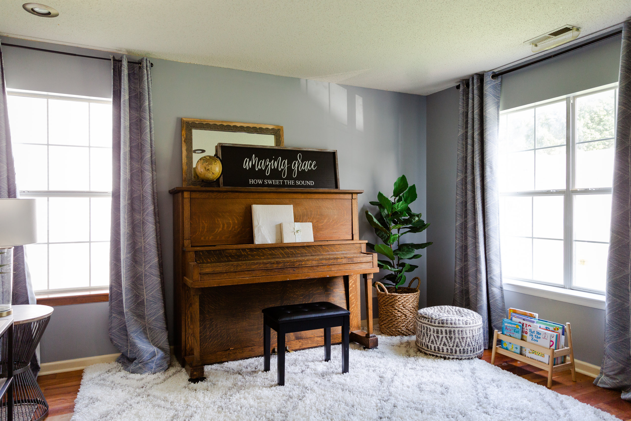 Whereas this piano used to be tucked away in the study, we brought it out into the living room, making it front-and-center!