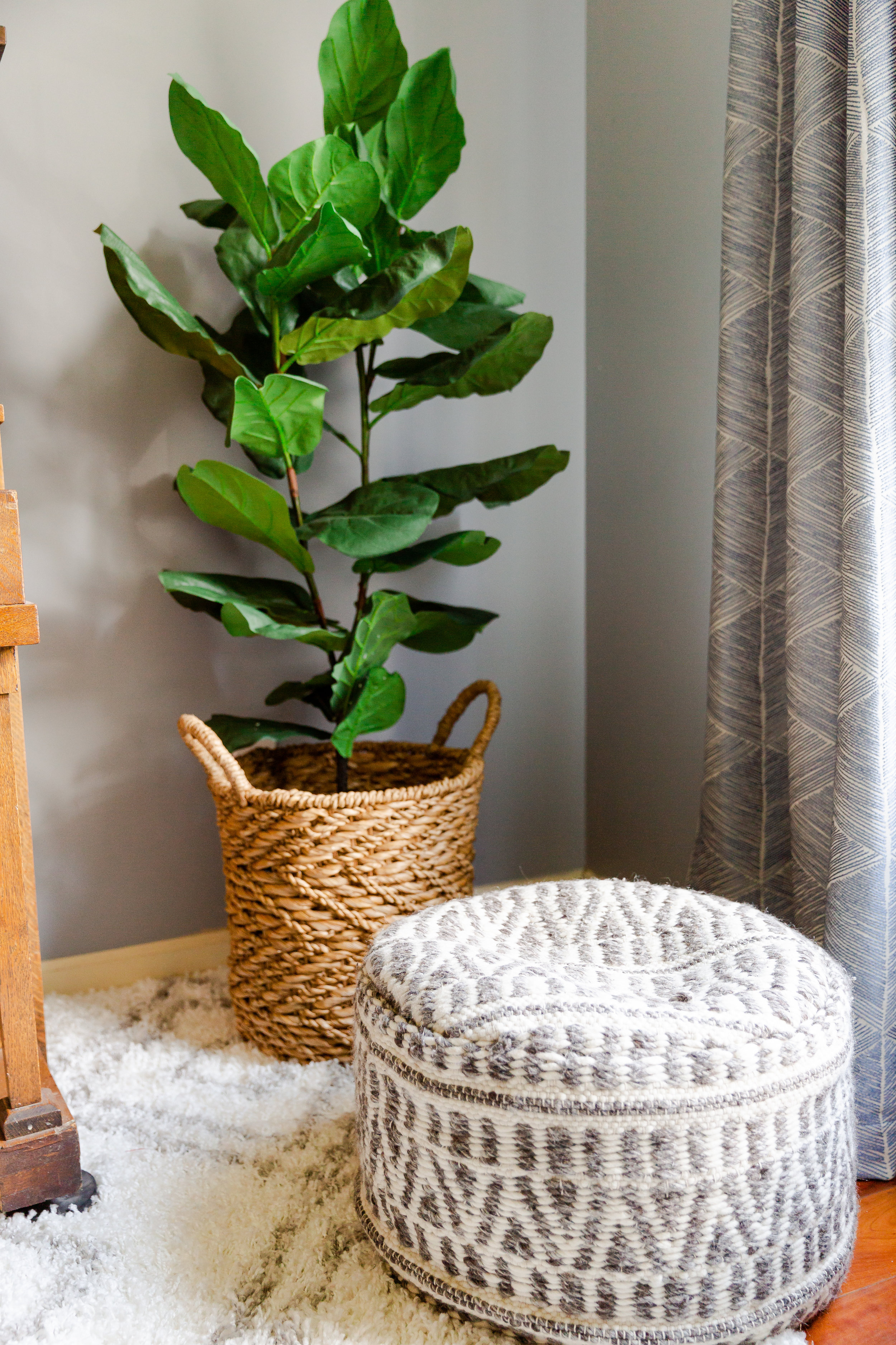 With all of the neutral tones going on in the living room, it was crucial that we added in pops of greenery!  This fiddle leaf fig tree certainly did the job.