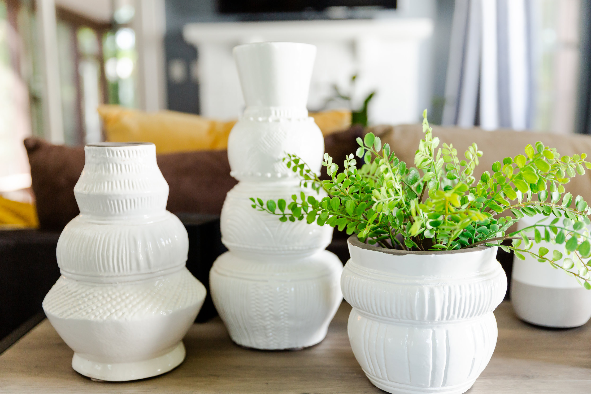 These carved white vases from Target were the perfect accessory for this living room!