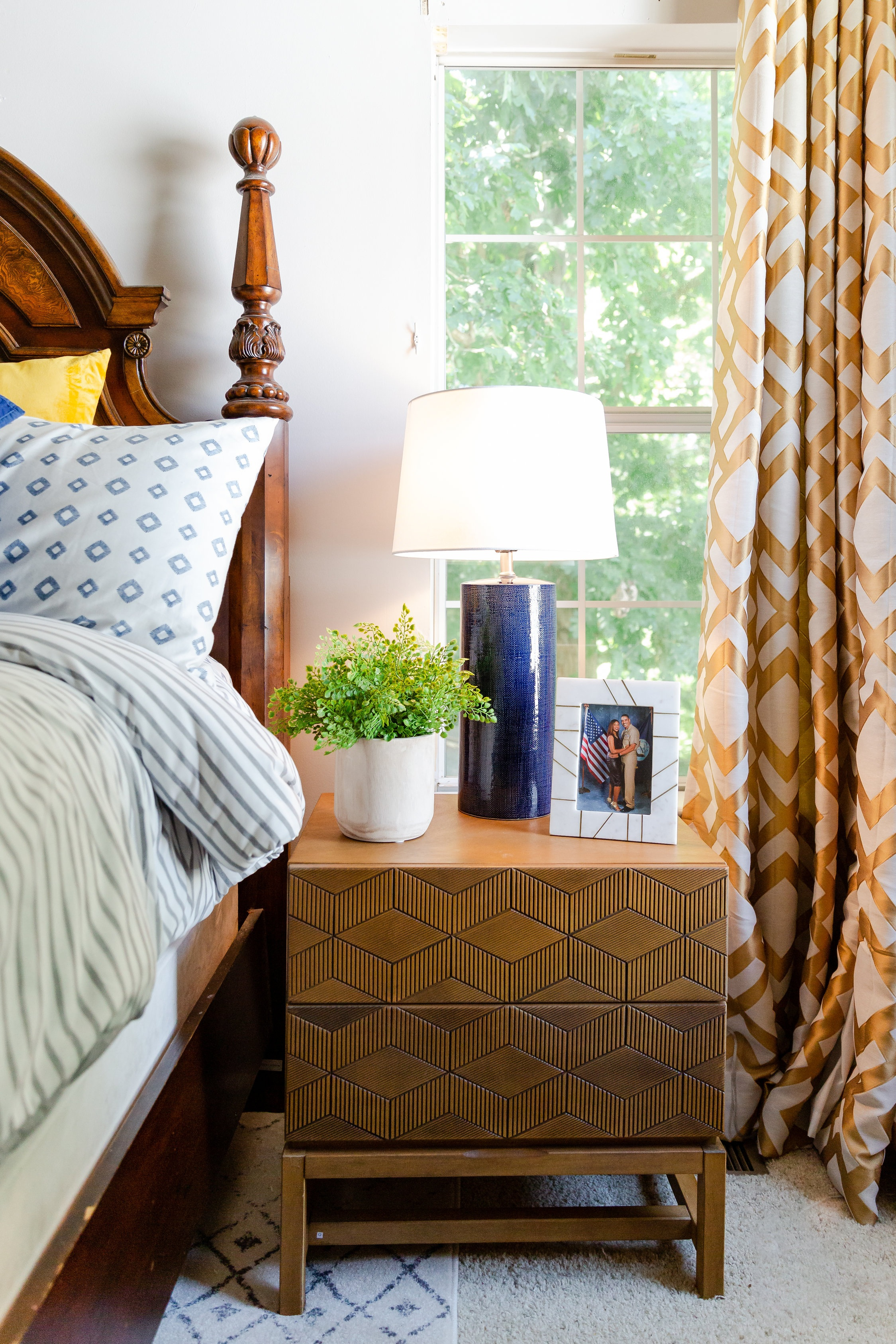 These side tables served a multitude of purposes such as: creating some balance (they anchor the bed), lighting things up (they're made of lighter wood), freshening things up (they feel a bit more modern than the existing furniture), and they provide storage!