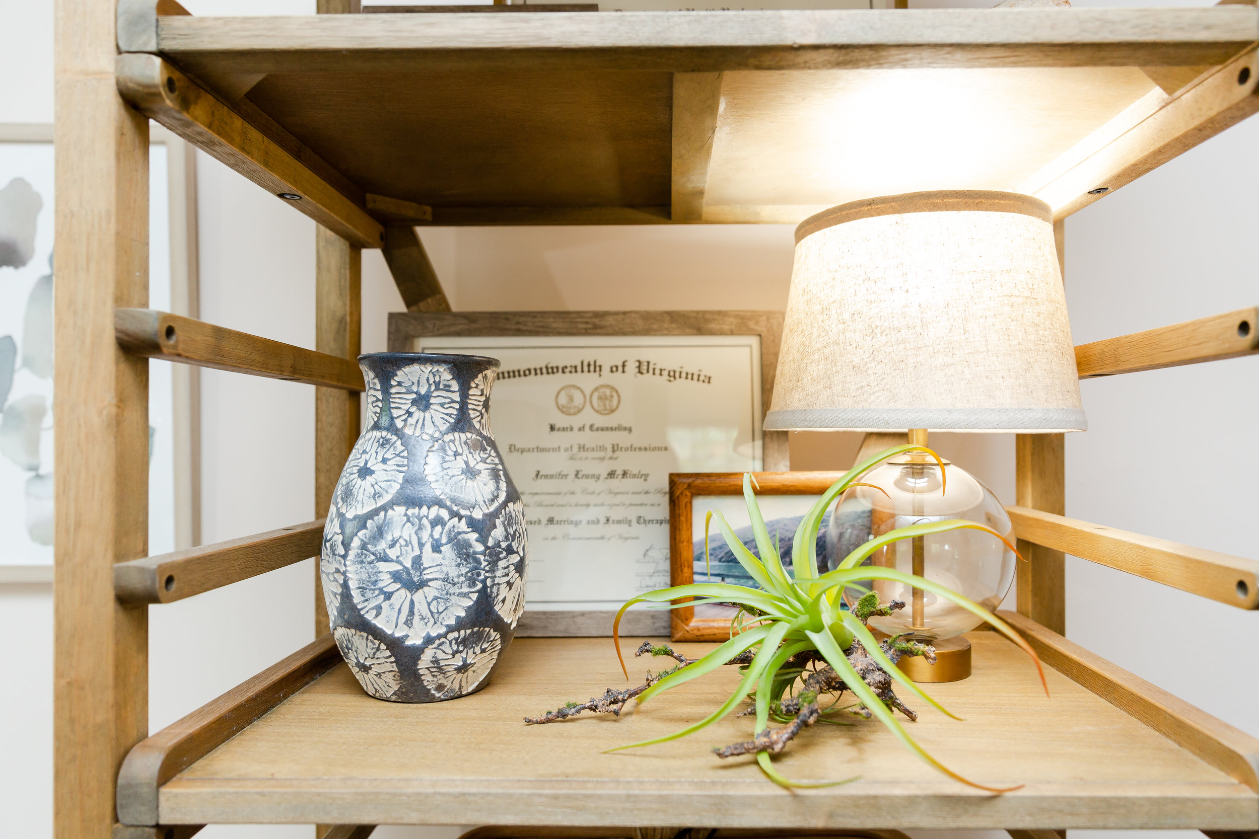 Looking back at the original design, I felt that this bookshelf looked a bit bare.  To flesh it out, I worked in these rattan baskets from World Market styled with some frames, ceramics, and crystals.