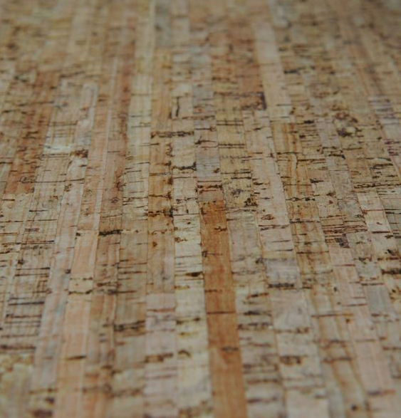 The natural finish of this cork floor is beautiful but most cork floors have a lacquer on top to protect from staining.