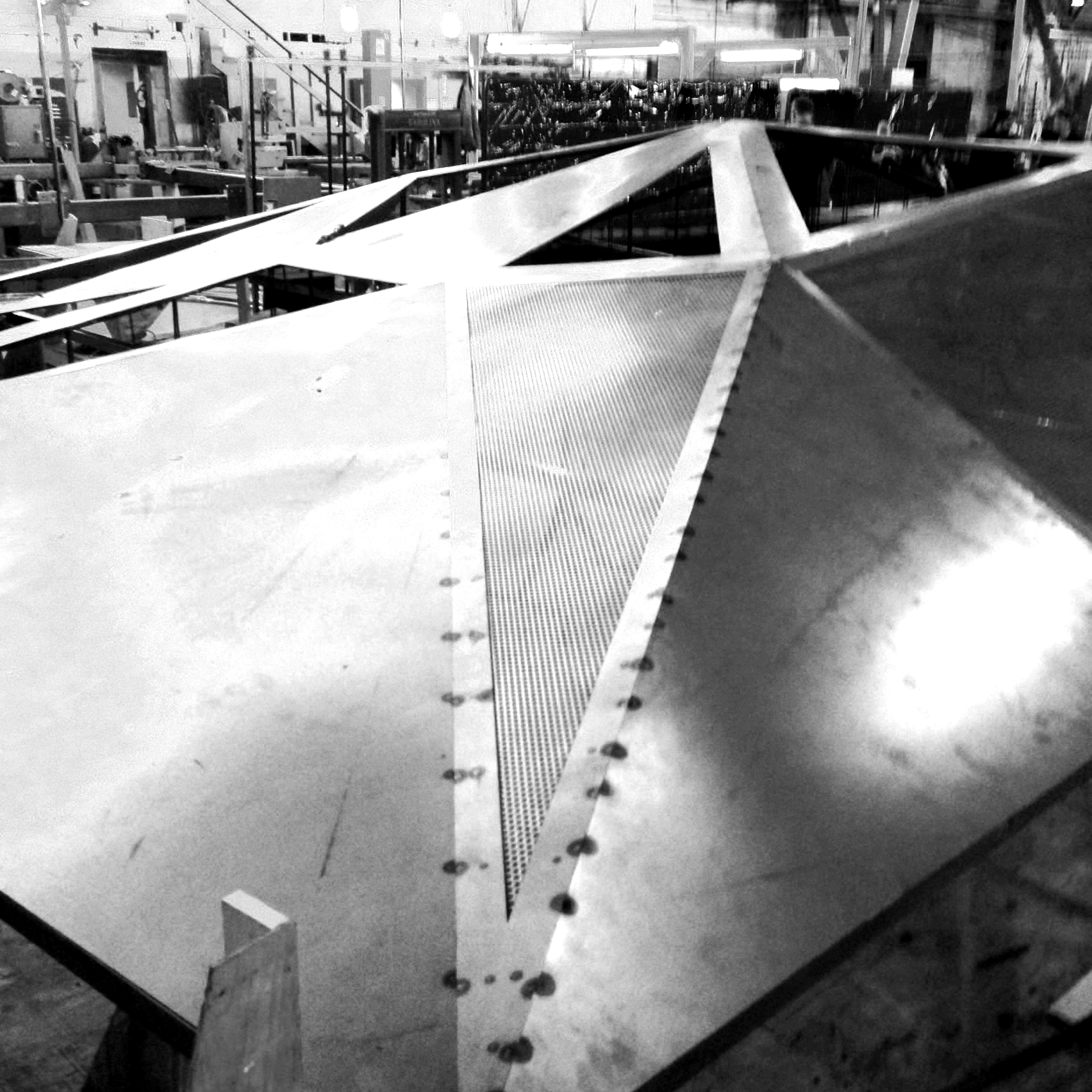 Welding the steel panels together.