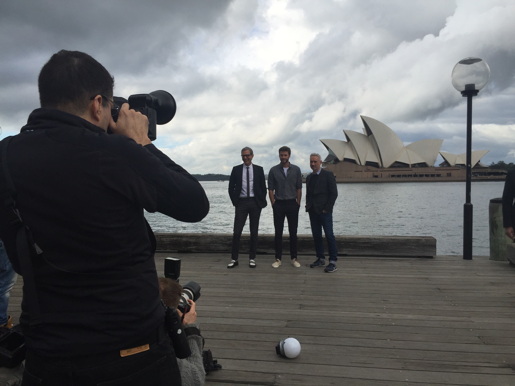 Roland, Jeff, and Liam at a photoshoot in front of the Sydney Opera House