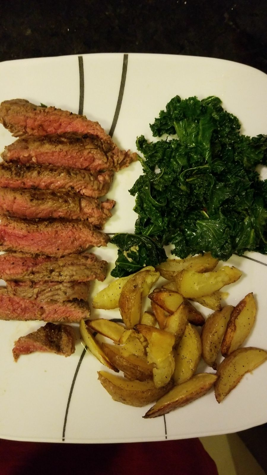 Sirloin w/sauteed kale and baked wedges