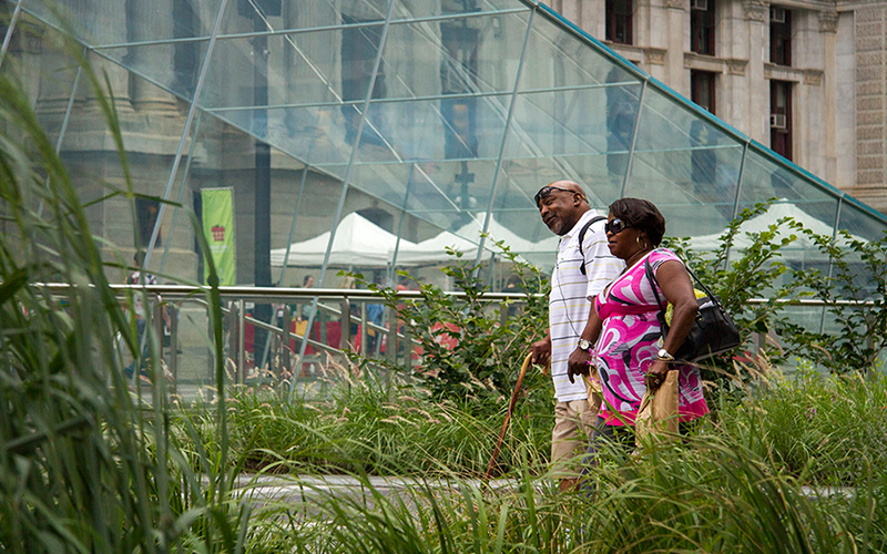 OLIN 's  Dilworth Park  is a universally-accessible public plaza at Philadelphia's City Hall. The formerly-sunken plaza was elevated to street level, eliminating the need for stairs and walls and improving access to City Hall. Photo courtesy: OLIN /  Sahar Coston-Hardy