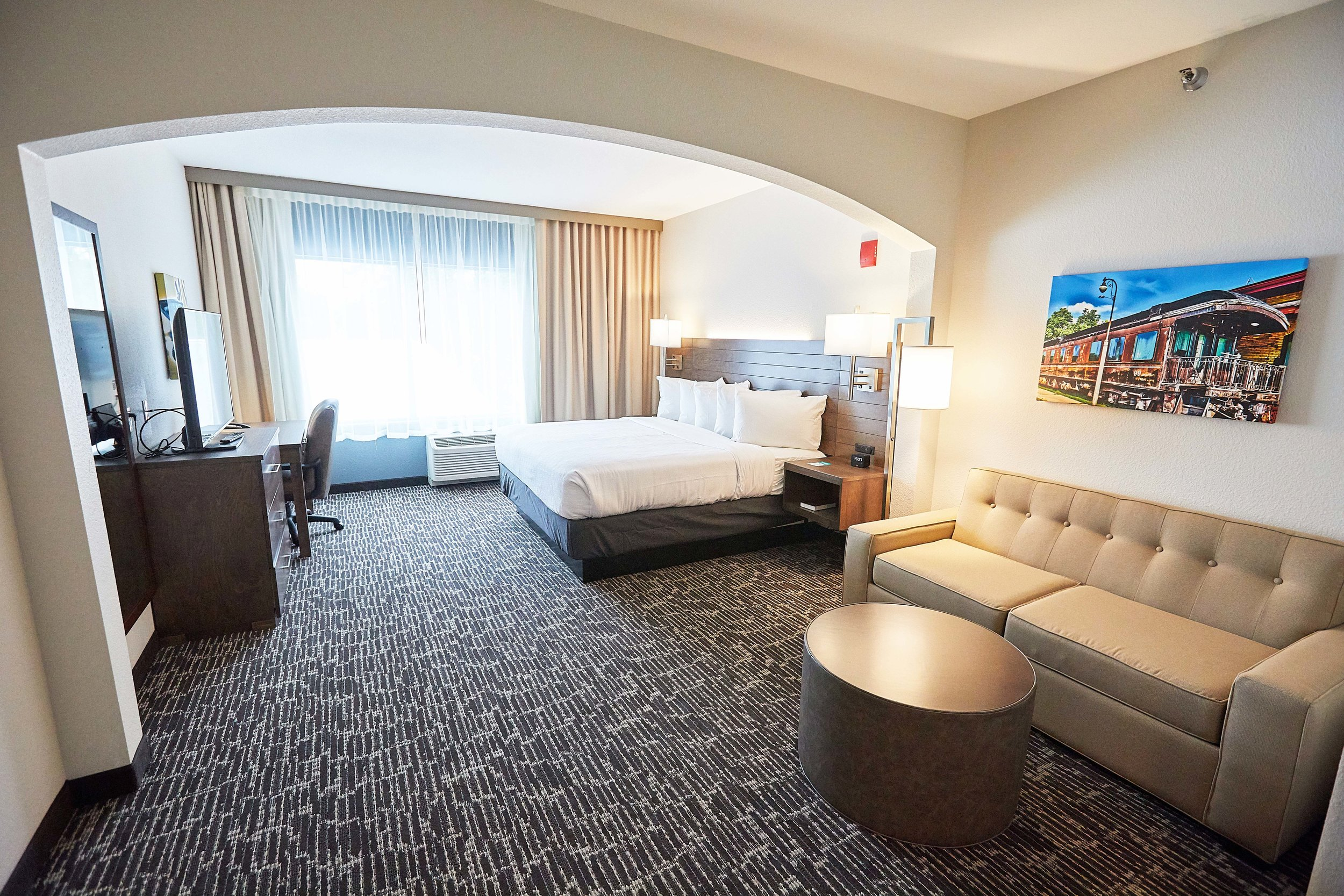 Spacious king executive studio room, with plush king bed and sleep sofa for up to 4 guests