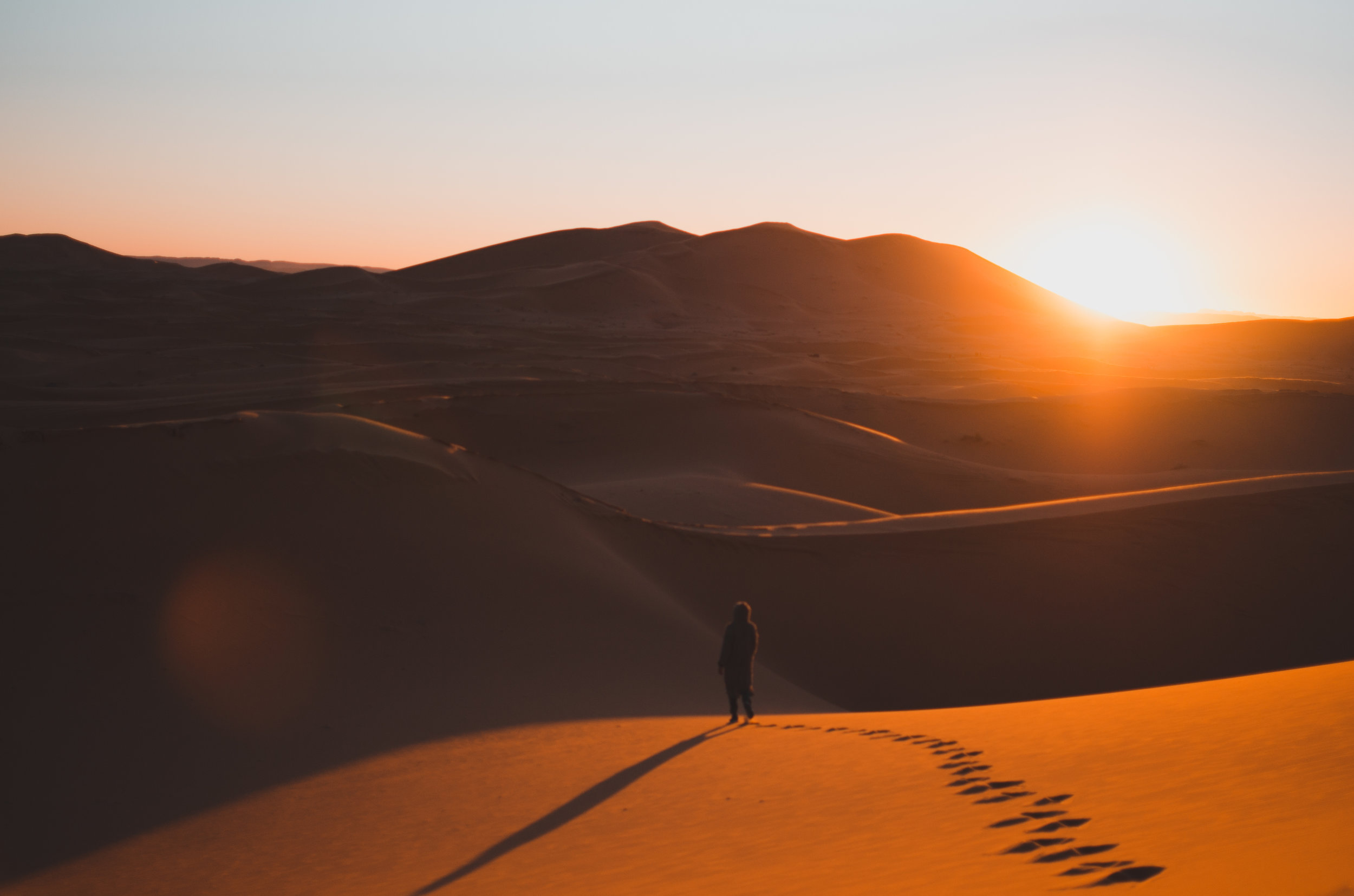 Our Moroccan guide watches the sun go down in the Sahara Desert