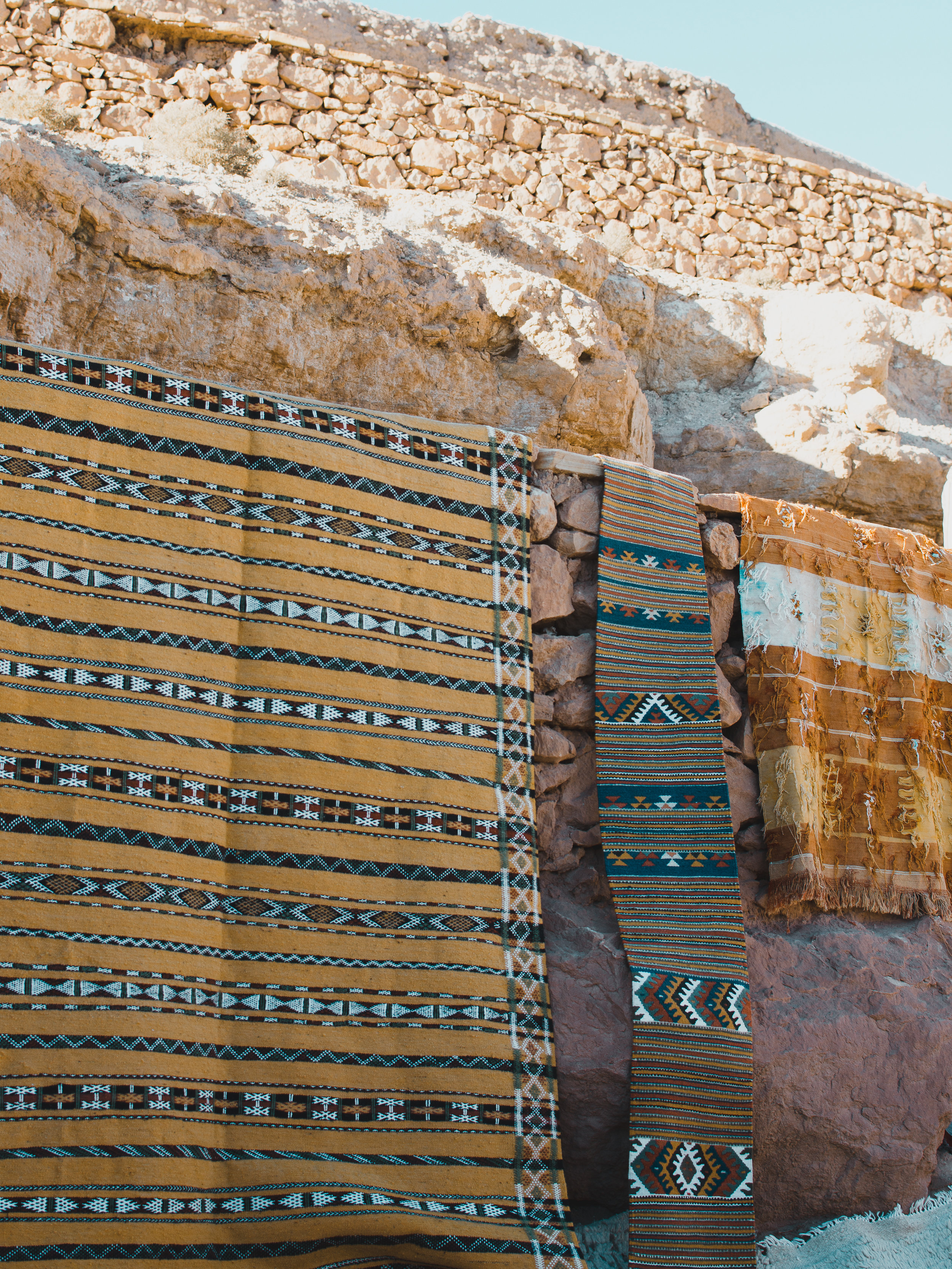 Admiring all the beautiful rugs at Ait Benhaddou in Morocco