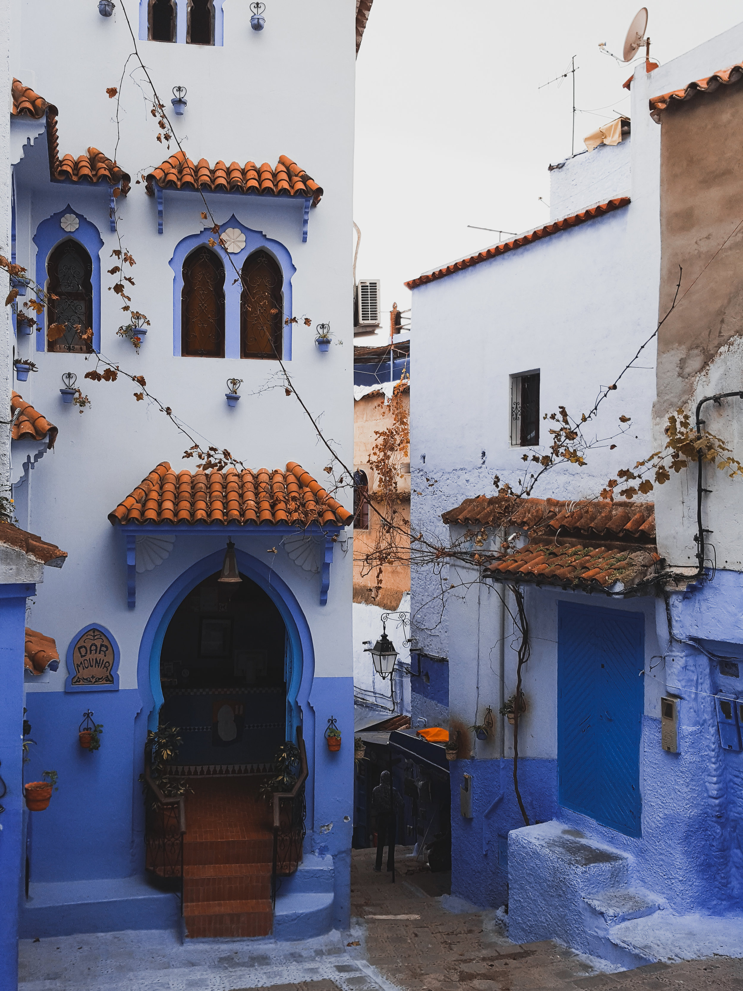 Orange and blue homes in Chefchaouen, Morocco