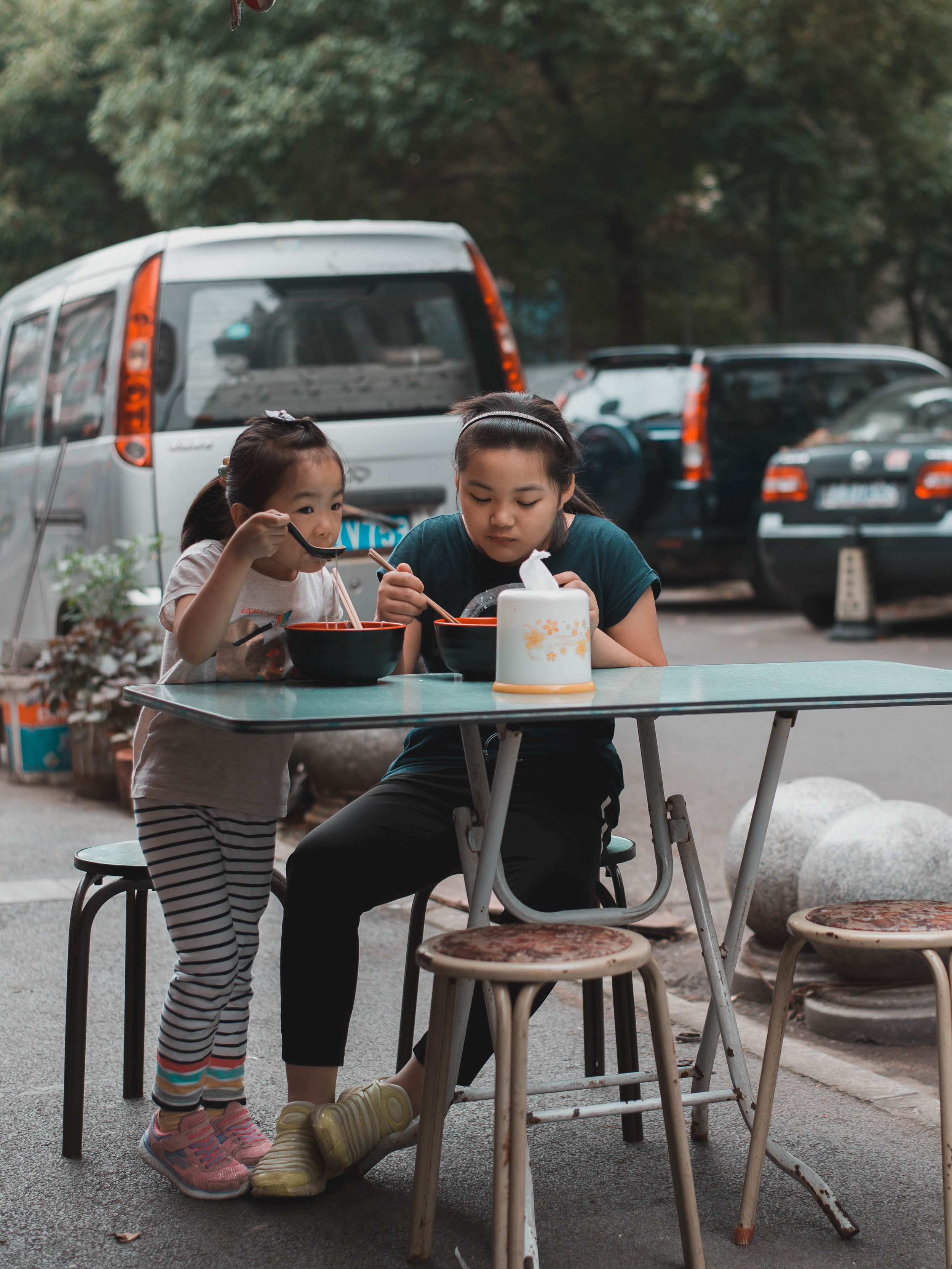 Two local Nanjing girls eating noodle soup