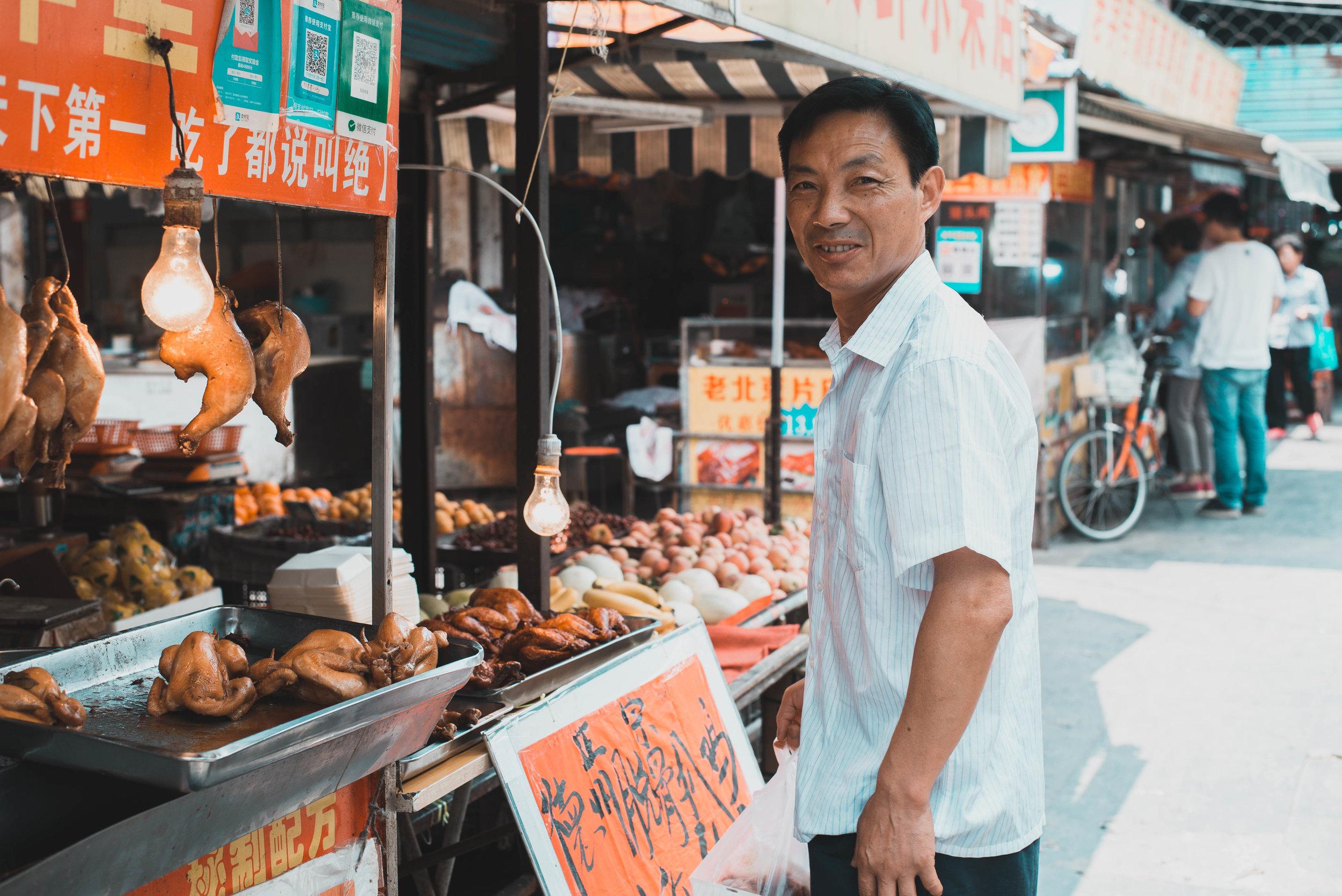A Nanjing local doing his daily shopping at a Nanjing street market