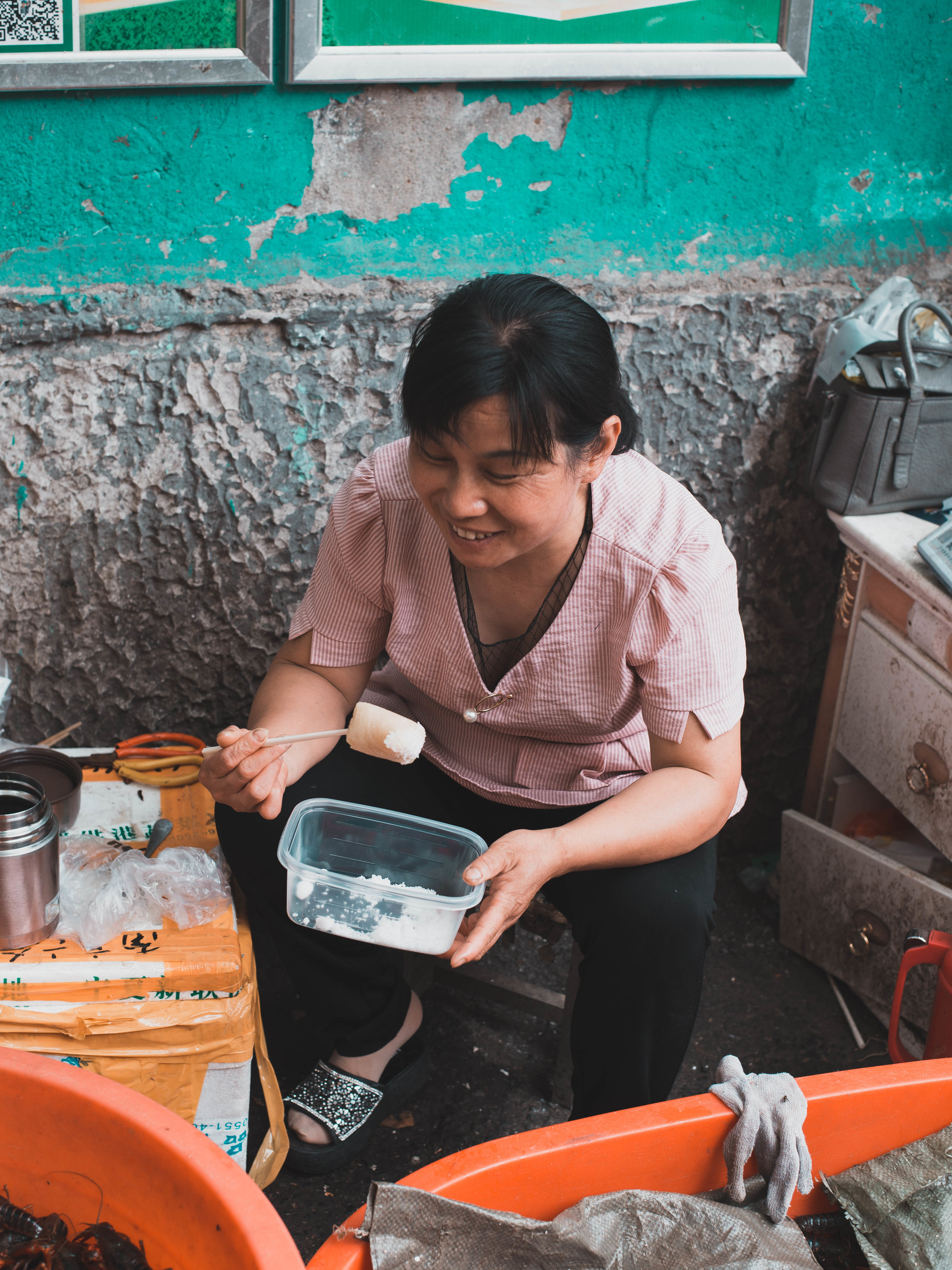 A vendor eats her lunch at a Nanjing wet market