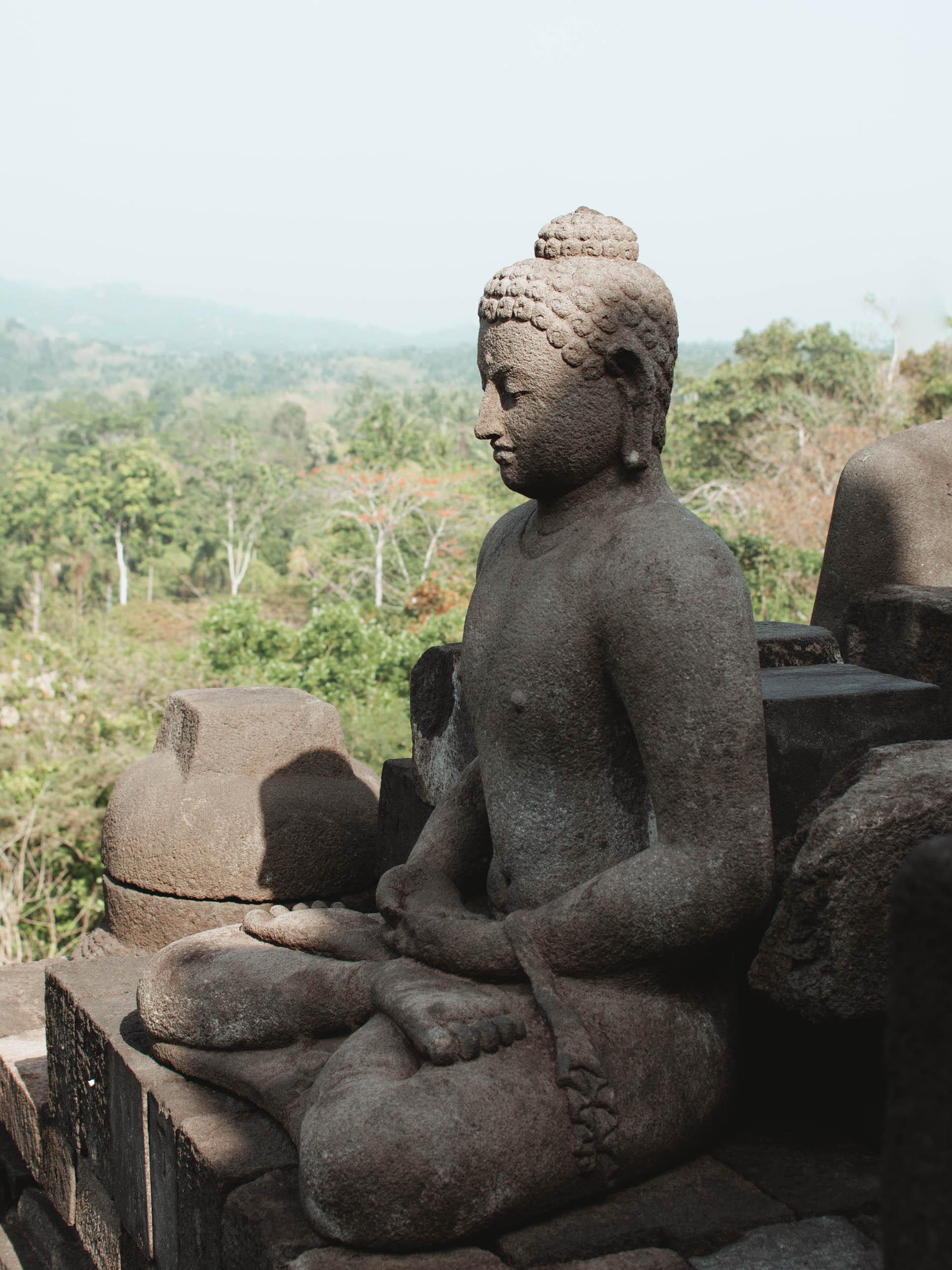 A carving of Buddha at Borobudur temple in Yogyakarta, Indonesia