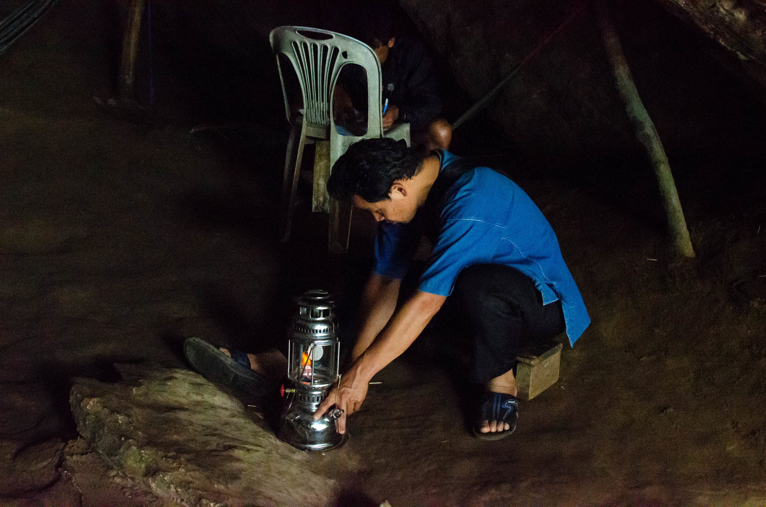 One of the Tham Lod Cave guides lighting a lantern