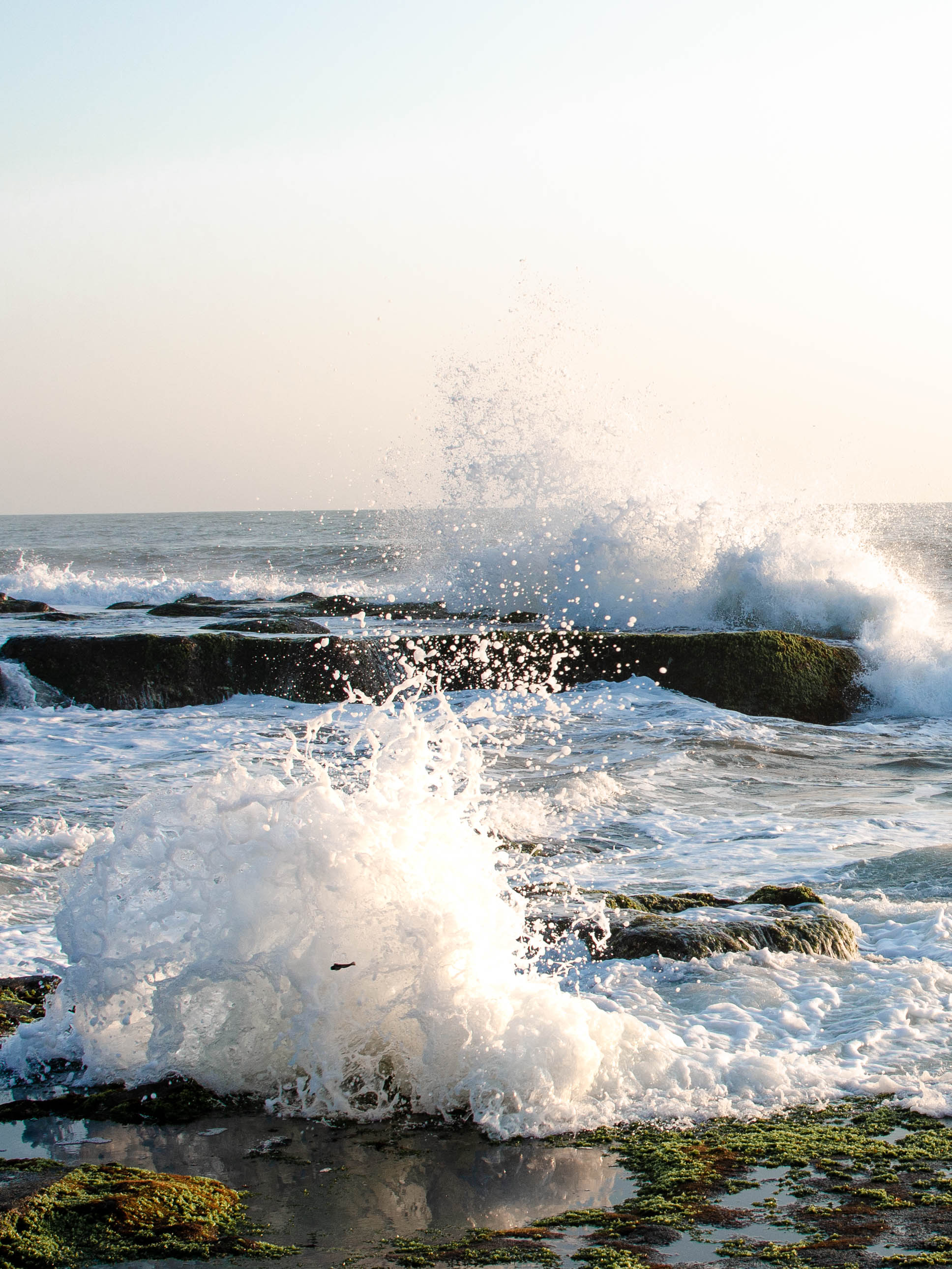 Visit Tanah Lot during low tide to get close up pictures of the waves